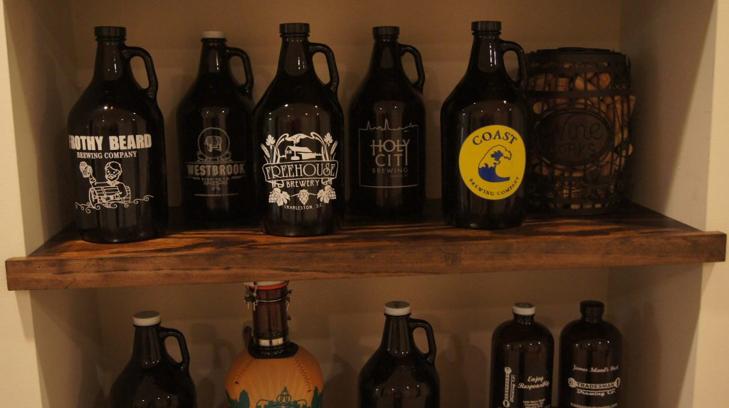 Charleston brewery growlers on floating shelf