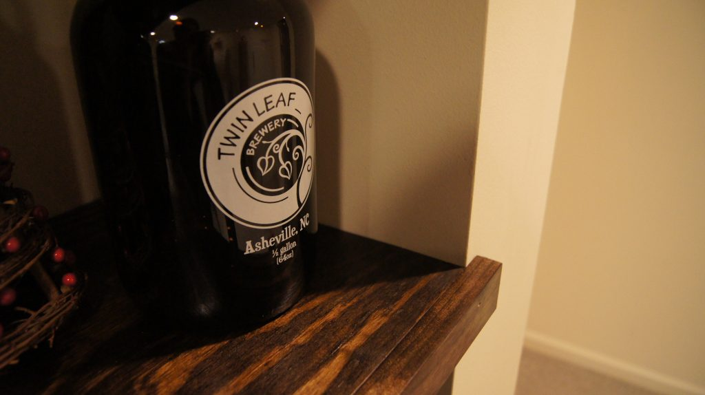 Twin Leaf Brewery Growler on floating shelf